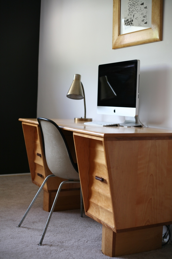 Black accent wall desk eames chair herman miller