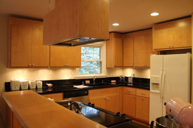 kitchen light wood black counters built in wood range hood