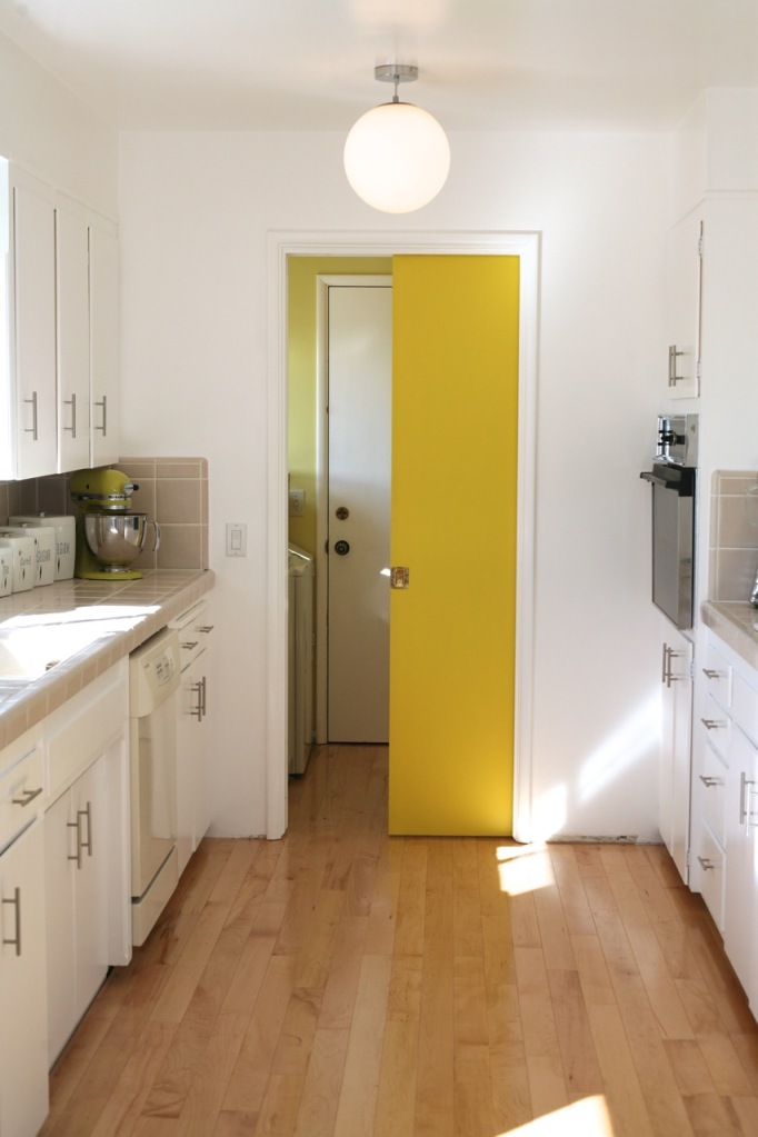 yellow pocket door kitchen mid century