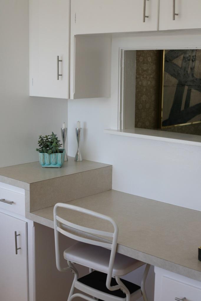 kitchen built in desk vintage turquoise planter white cabinets