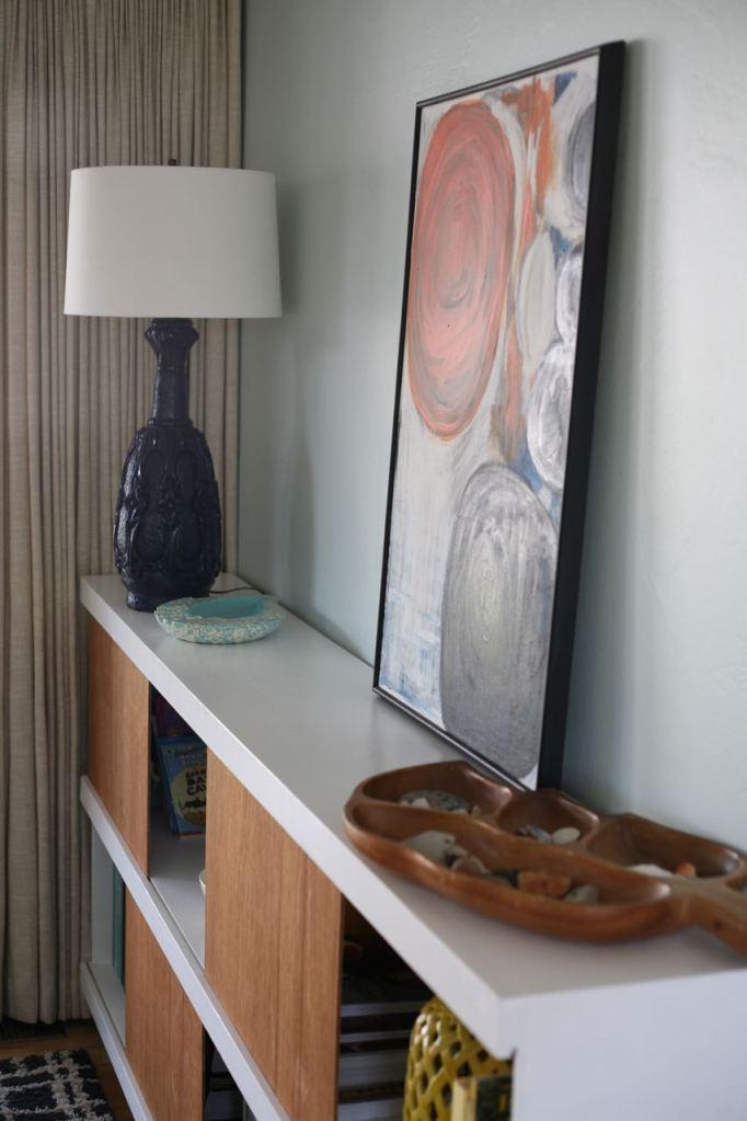Vintage blue lamp on bookshelf