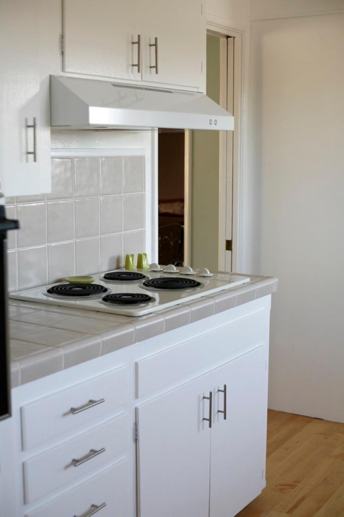 white range hood cabinets kitchen