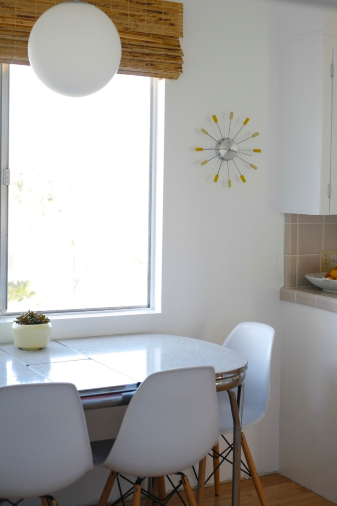 Eames chairs white kitchen formica table mid century starburst clock yellow