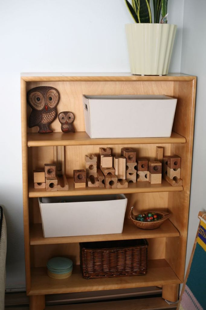 Blond wood shelf toys