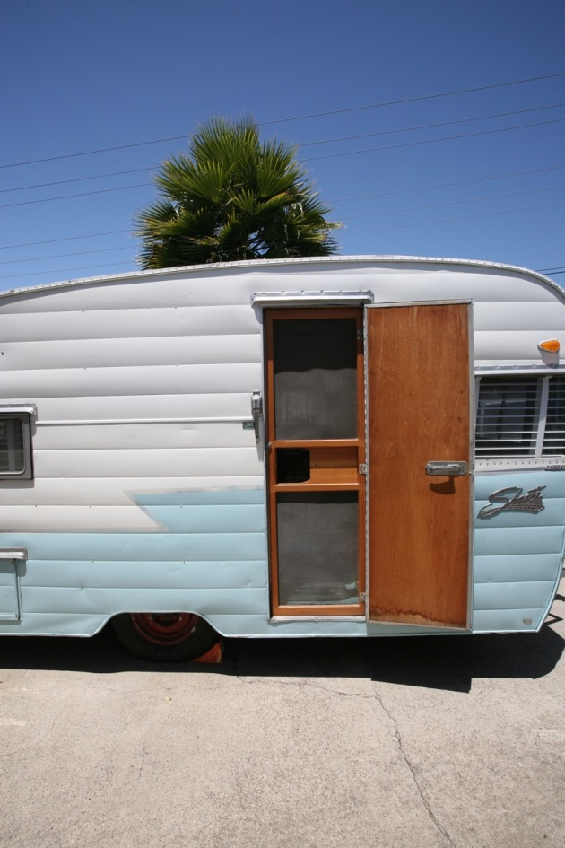 1958 Shasta Airflyte vintage trailer RV camper blue turquoise white wings door