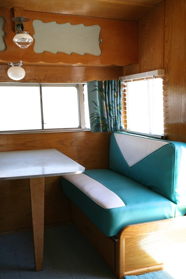 Shasta trailer vintage interior dinette vinyl upholstery barckcloth curtains blinds kitchen turquoise blue linoleum