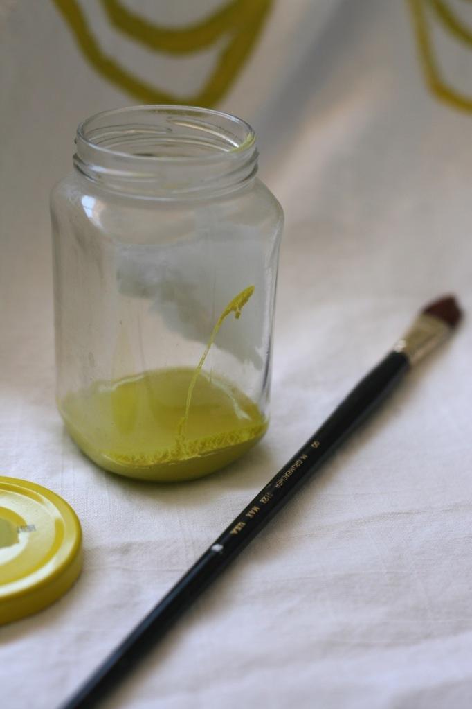 paint jar and brush yellow