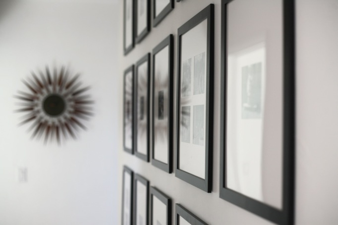 black white photo gallery wall portraits hall frames grid ikea 11x16