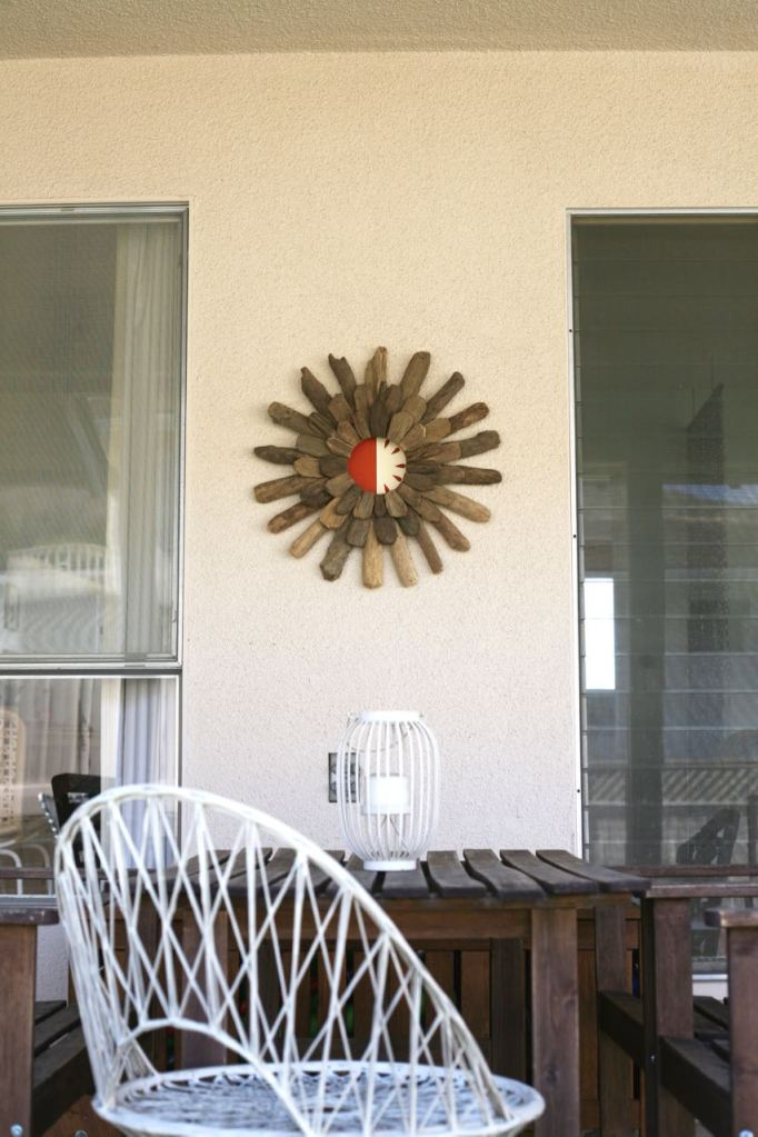 driftwood starburst painting woodard spun fiberglass chair patio