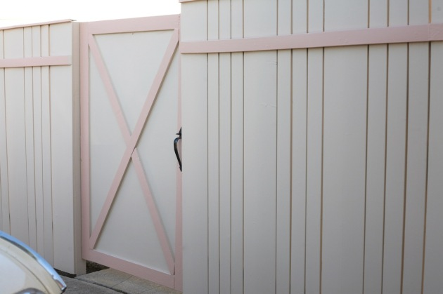 midcentury 60's fence and gate pink peach barndoor barn door x