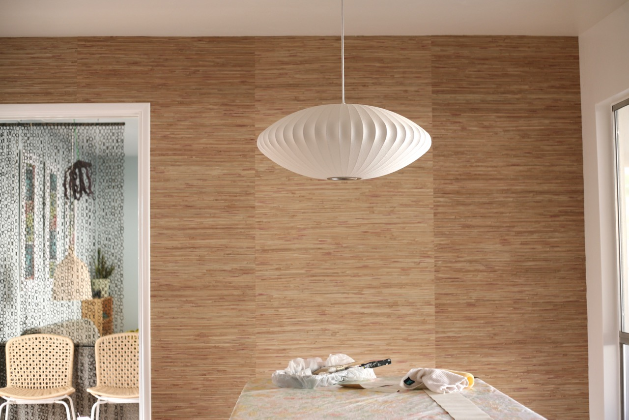 grasscloth wallpaper mid century dining room accent wall