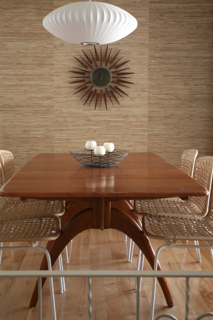 mid century dining room grasscloth wallpaper starburst clock nelson bubble light heywood wakefield wishbone table