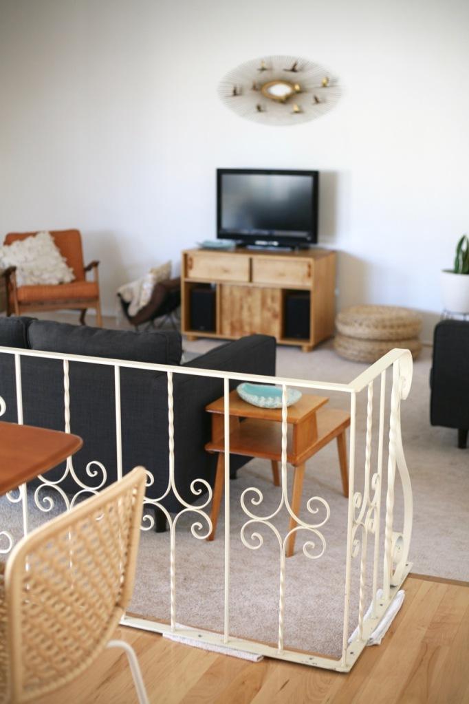mid century sunken living family room couch railing rail divider