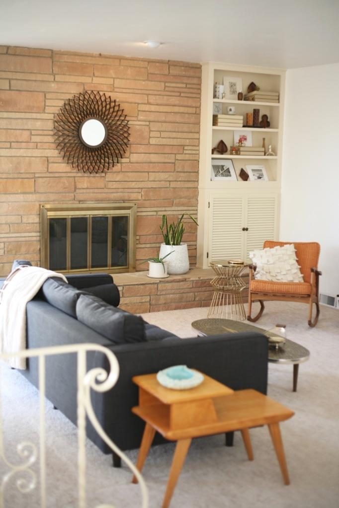 mid century sunken living family room couch rock fireplace danish