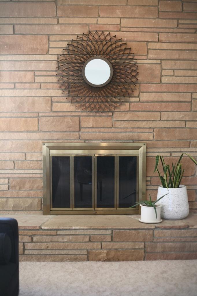 mid century rock fireplace brass insert doors nelson sunflower mirror