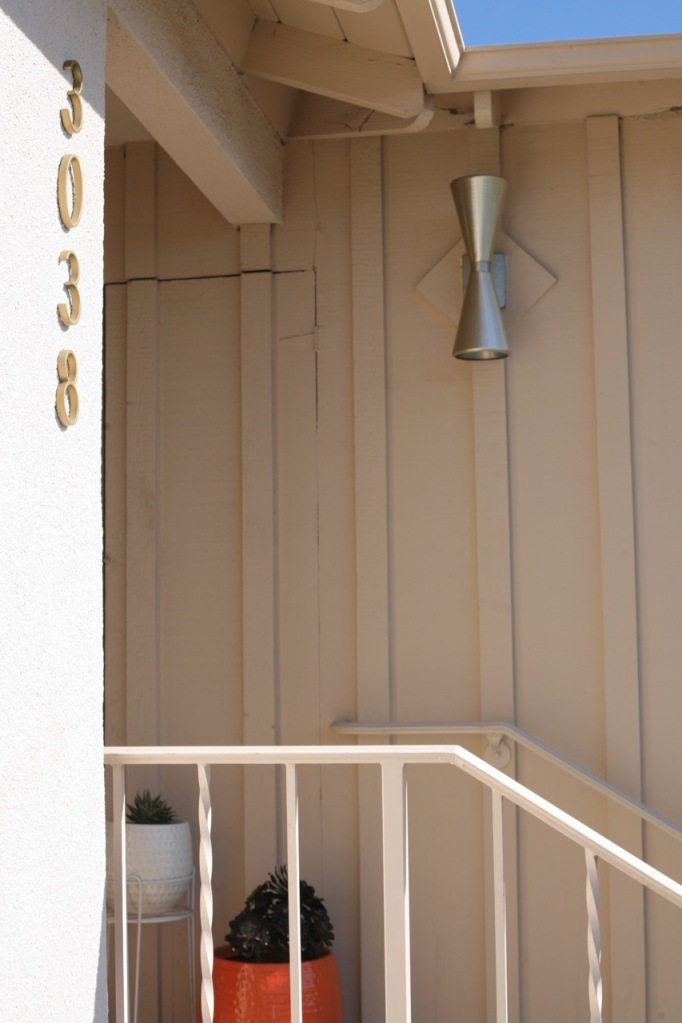 mid century porch entry house numbers address cone light board and batten stair rail