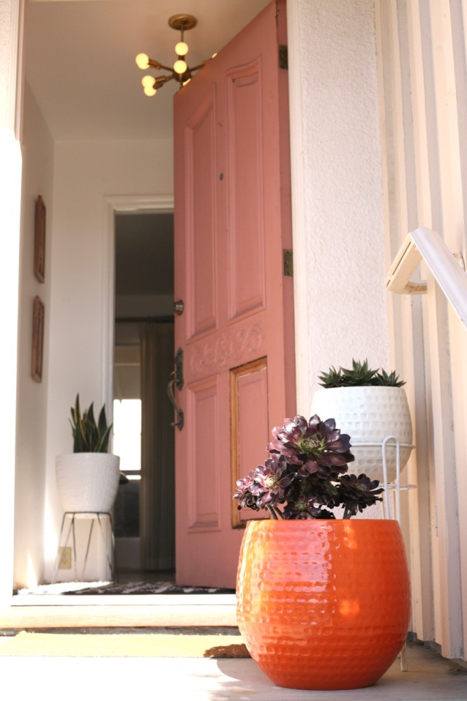 pink front door orange planter sputnik entry light