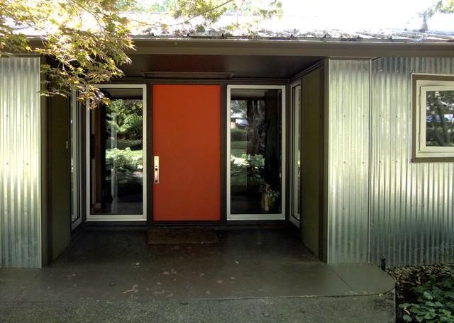 brass handleset orange door mid century