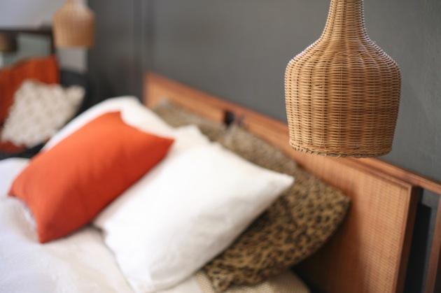 mid century danish wicker sconce cane headboard bedroom bed black wall