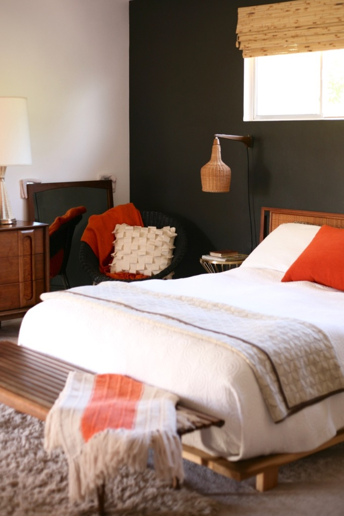 black accent wall bedroom mid century interior orange