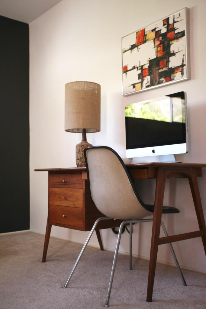 mid century modern danish desk eames chair black accent wall