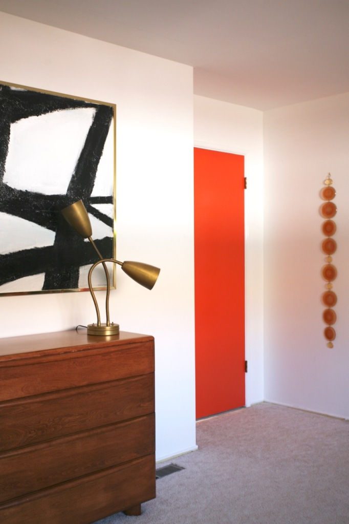 mid century modern interior bedroom orange white black