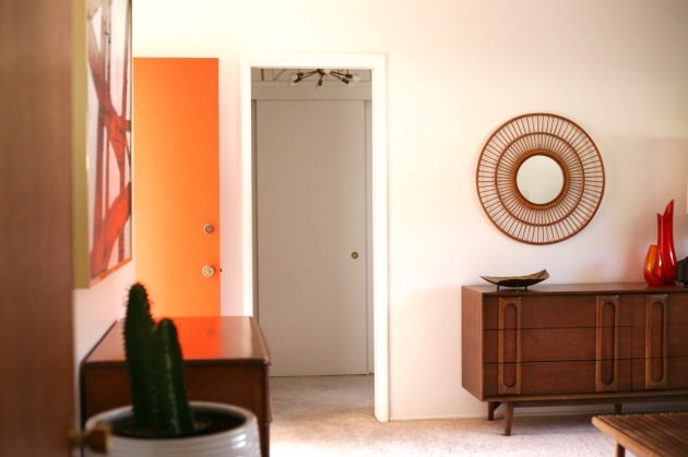 mid century interior bedroom orange door
