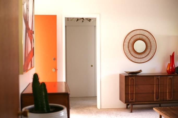 mid century interior bedroom orange door