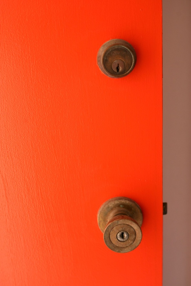 orange door mid century brass hardware behr fireglow