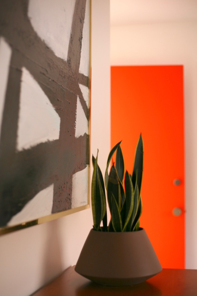 mid century interior bedroom orange black white abstract painting cb2 roz planter behr fireglow
