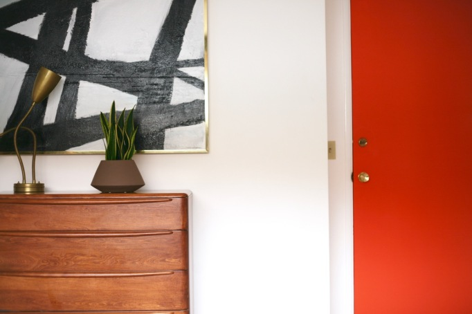 mid century modern bedroom heywood wakefield encore dresser abstract painting white walls orange door