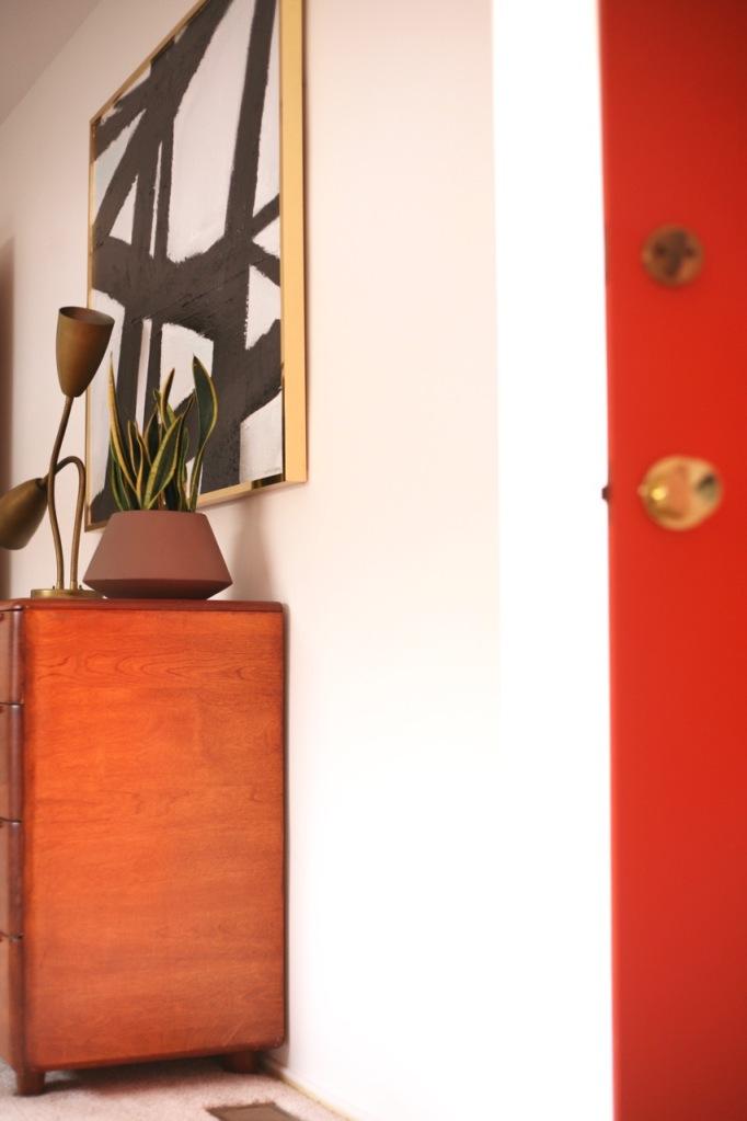 mid century modern interior bedroom orange white black