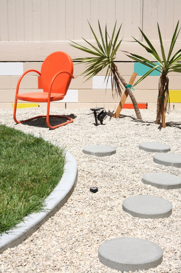 mid century yard landscape exterior painted mosaic cinderblock cinder block brick retaining wall motel chair orange colorful backyard yucca