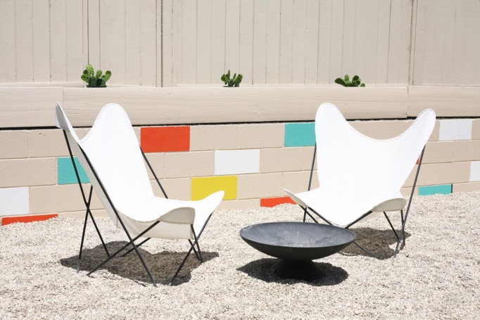 mid century yard landscape exterior painted mosaic cinderblock cinder block brick retaining wall butterfly chairs firepit colorful backyard