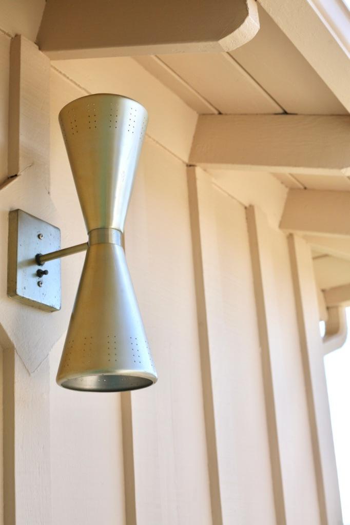 mid century double cone exterior light brass