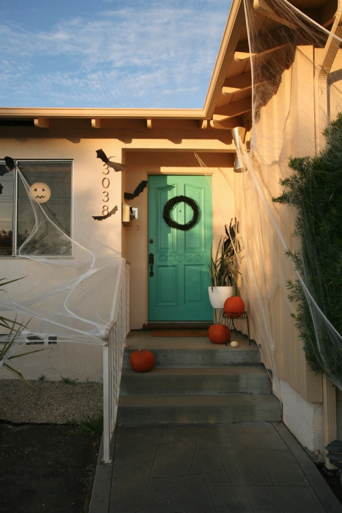 mid century modern halloween decorations front door spider webs bats