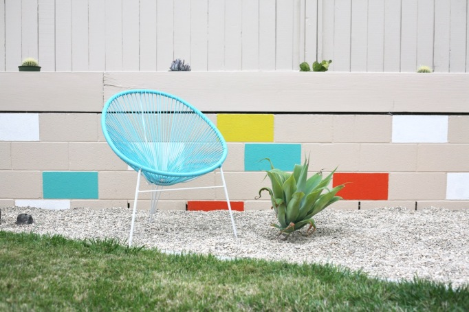 blue acapulco chair backyard