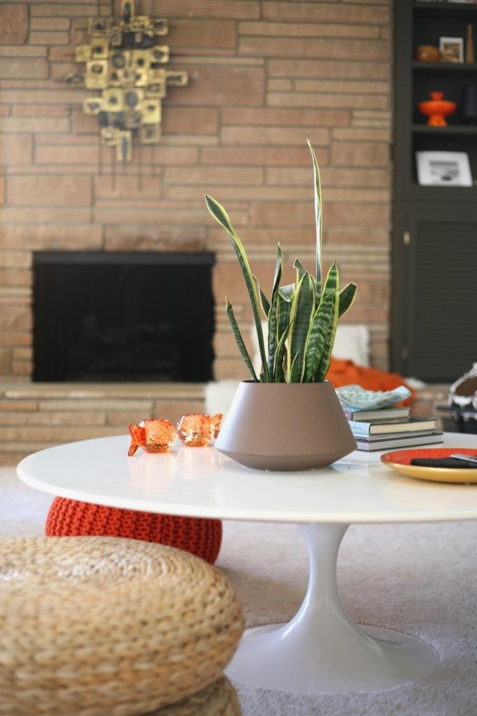 mid century family living room fireplace tulip coffee table saarinen