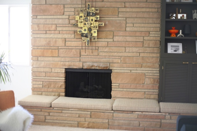 mid century rock fireplace brutalist sculpture cushions hearth