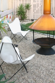 mid century vintage malm cone fireplace backyard patio outdoor yellow orange preway butterfly chairs firepit