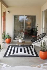 mid century patio backyard black white acupulco chairs
