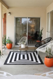 mid century patio backyard black white acupulco chairs