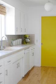 mid century yellow white kitchen maple woodfloors globe lights