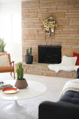 mid century family living room rock fireplace