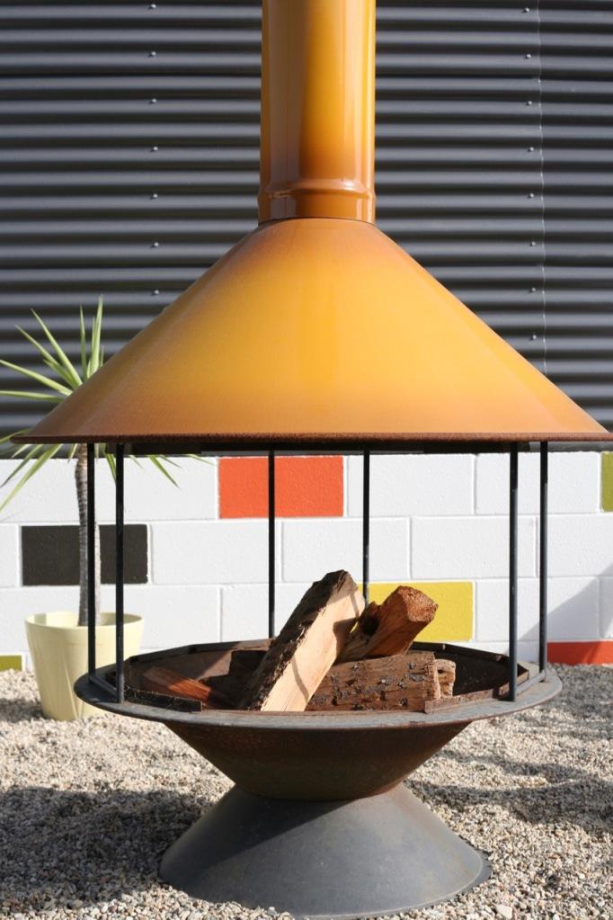 vintage orange malm preway carousel fireplace in modern backyard
