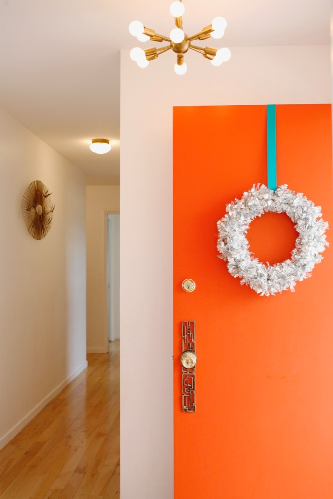 mid century orange front door christmas wreath tinsel silver retro vintage holiday christmas sputnik light