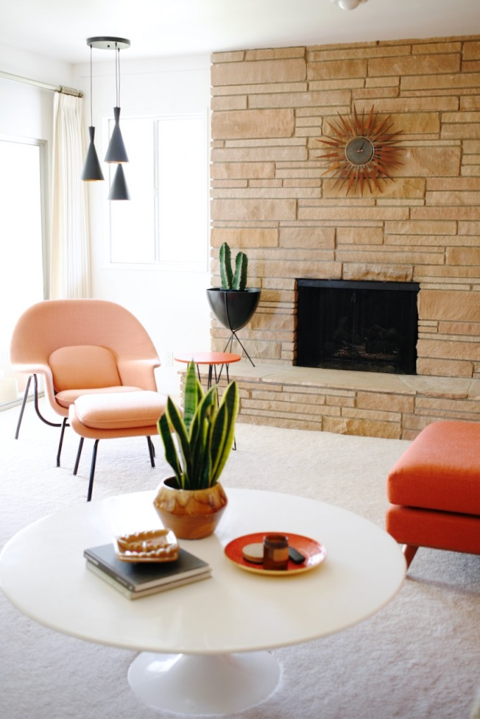 mid century family living room orange womb chair rock fireplace